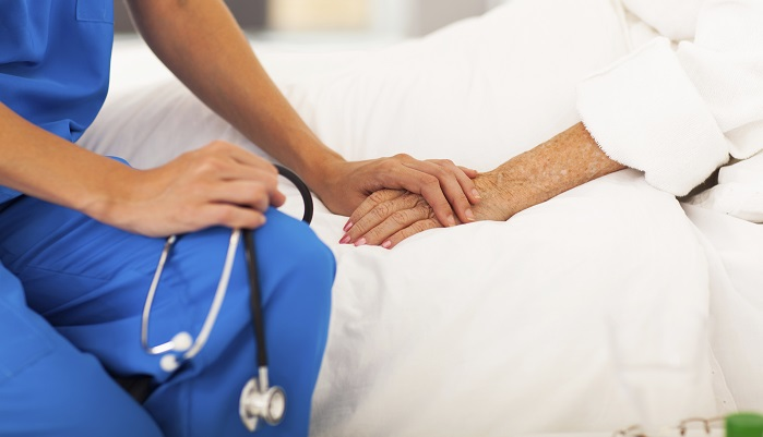 nurse caring for bedridden patient
