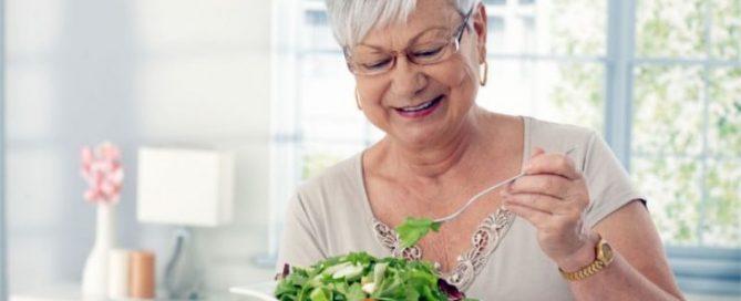 Elderly woman eating healthy