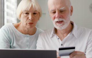 senior couple shopping online medical supplies