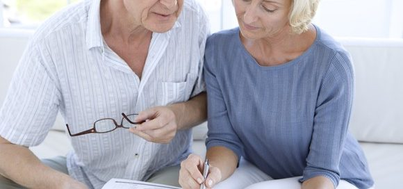 older couple reviewing medical bills - reducing medical costs