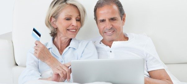 Elderly couple shopping for mattress