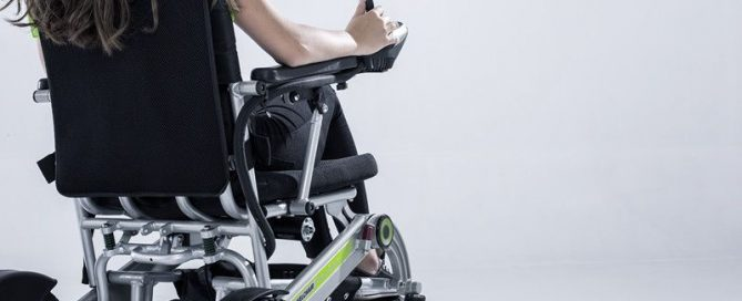 girl using portable electric wheelchair