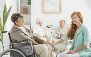 Nurse talking to lady in wheelchair