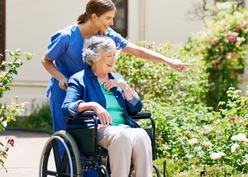 senior in wheelchair with nurse