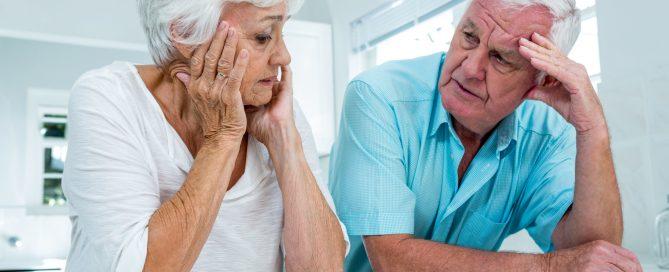 senior couple discussing SSDI