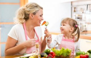 mom and daughter eating healthy