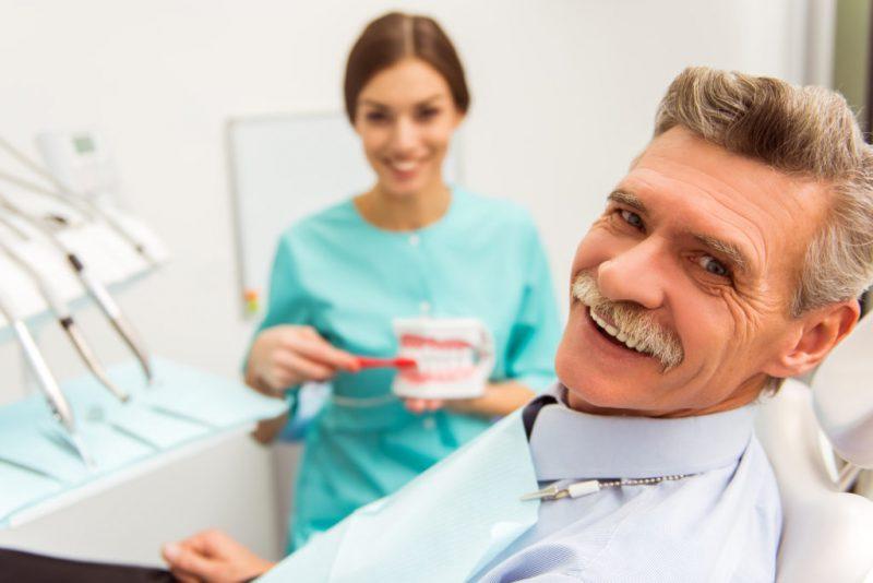 happy senior patient at dentist