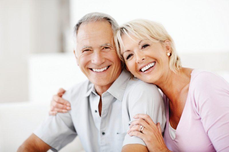 smiling senior and caregiver