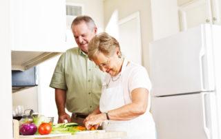 seniors cooking healthy dinner