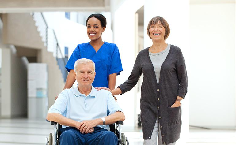 nurse wheeling patient