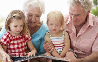Grandparents And Grandchildren Reading Book